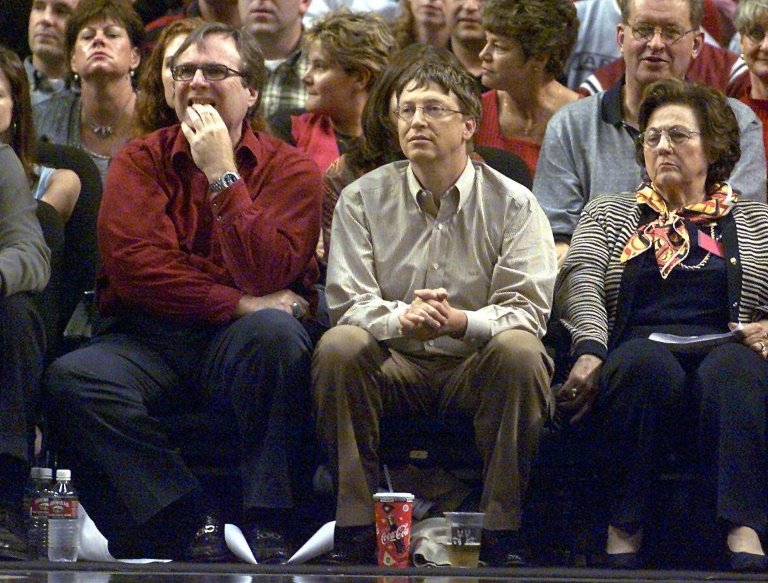 Microsoft co-founders Allen, left and Bill Gates watch the third game of the Western Conference Finals between the Los Angeles Lakers and the Portland Trail Blazers in Portland, Oregon on May 26, 2000