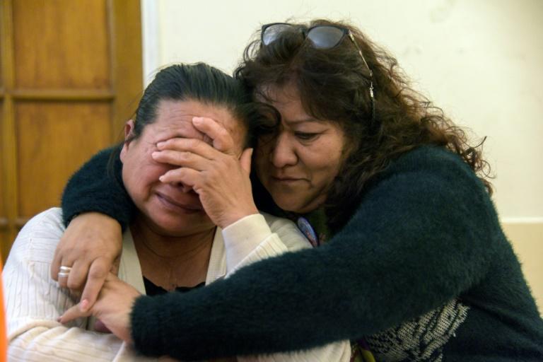 Francisca Soria (L), mother of missing crew member David Melian, is embraced by Victoria Morales, mother of submariner Esteban Garcia, in Mar del Plata, Argentina, on November 07, 2018