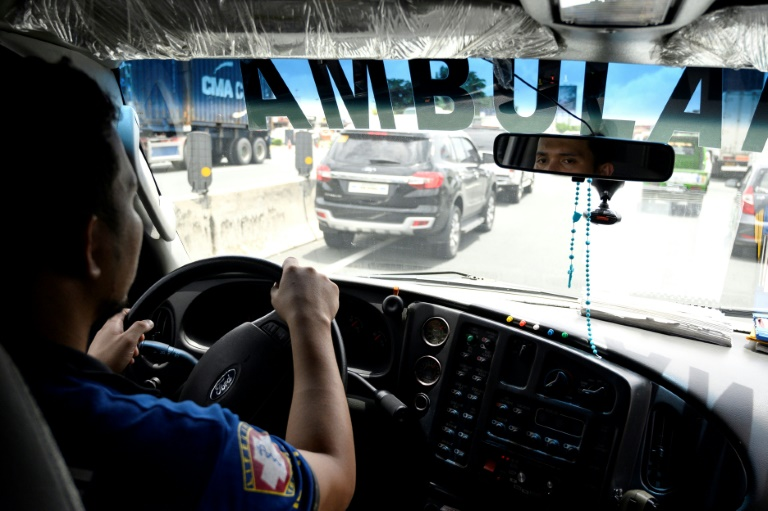 Patients die as Manila traffic jams block ambulances | AFP