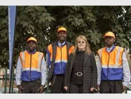 Makala Matondo, Alain Ituma, Vivienne Marincowitz and Mayou Nglenga stand together to keep Tyrone Avenue safe.