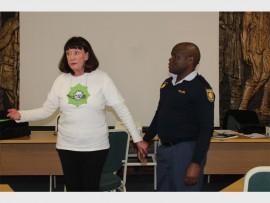 Penny Steyn, with Constable Mmatlou Mokoka of Rosebank police, explains the importance of forensics.