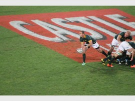 Springbok scrumhalf Ruan Pienaar passes the ball from a scrum during their game against New Zealand.