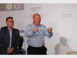 Brad Bergh of Engen and Stanley Matthews of SuperSport United at the Engen Champ of Champs draw.