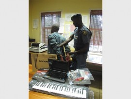 Sergeant Soza Mabunda of the Hillbrow Tactical Response Team apprehends a theft out of motor vehicle suspect.