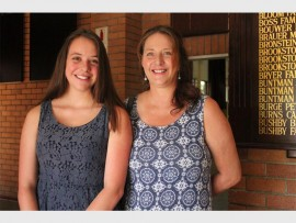 Daniella Nasya Neville got six distinctions stands with her proud mother Nicky Neville.