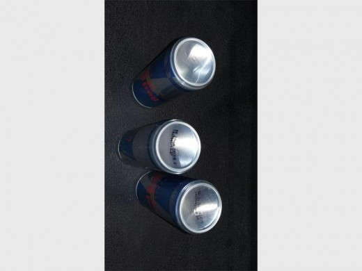 Two suspects who were arrested for hijacking a Nestle truck were also found in possession of a machine which changes expiry dates on Red Bull cans.