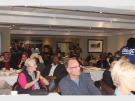 Attendees listen to DA mayoral candidate Herman Mashaba.