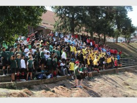 Parktown Boys' High School held its inter-house athletics competition and saw pupils from different houses competing against each other in track and field races, as well as other pupils cheering their teammates on and wearing house colours.