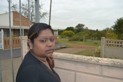 Janice Govender points to the direction of the vacant land that has become a haven for criminals.
