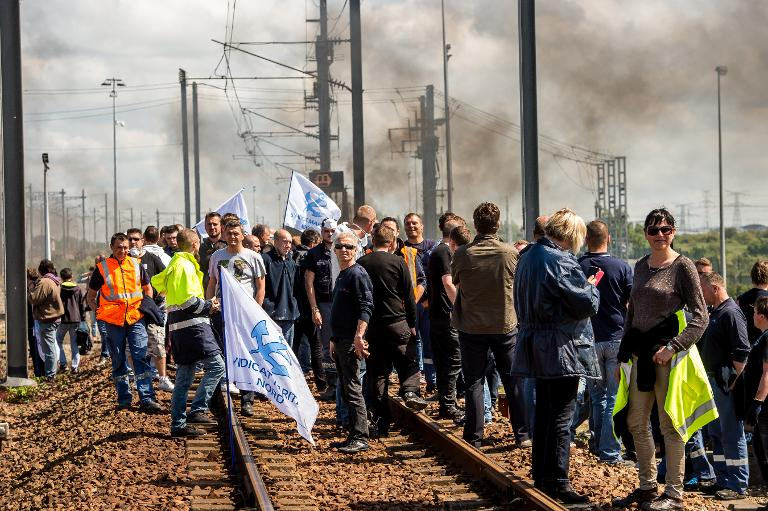 18b798d97534a Protesters block the railway tracks of the Eurostar line in Calais