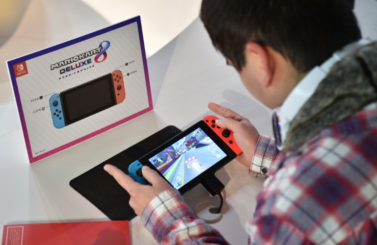 A visitor plays a Nintendo's new Switch game console during its game experience session in Tokyo on January 14, 2017 | © AFP/File | KAZUHIRO NOGI