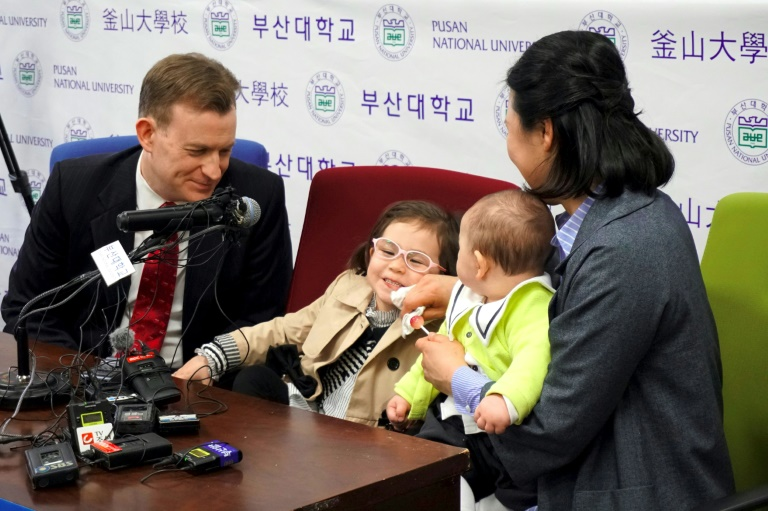 Professor Robert Kelly (L), who became an internet hit after his children crashed a live BBC interview, attended a press conference on March 15, 2017 with his wife Kim Jung-A (R), daughter Marion (2nd L) and toddler son James (2nd R) | © AFP | Yelim LEE