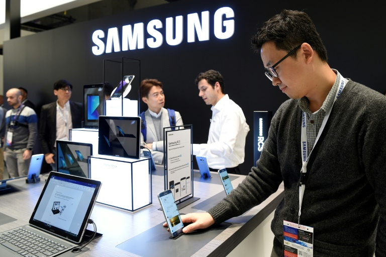Samsung, whose booth at this year's Mobile World Congress is shown here, is unveiling a new personal assistant 'Bixby' that will challenge rivals including Apple's Siri and Amazon's Alexa | © AFP/File | LLUIS GENE