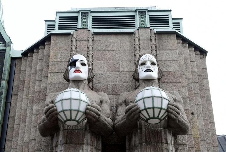 Statues painted with masks in tribute to rock band KISS at Helsinki's central station, pictured on April 28, 2017   © Lehtikuva/AFP   Vesa Moilanen