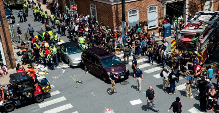 People receive first aid after a car ran into a crowd of protesters in Charlottesville, Virginia on August 12, 2017   © AFP   PAUL J. RICHARDS