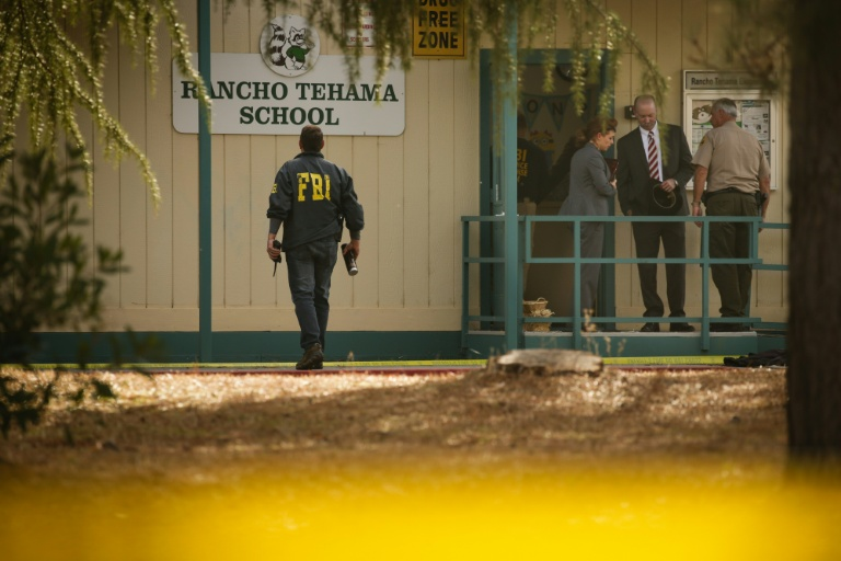 FBI agents and police are seen outside the Rancho Tehama Elementary School after a shooting on November 14, 2017   © AFP   Elijah Nouvelage