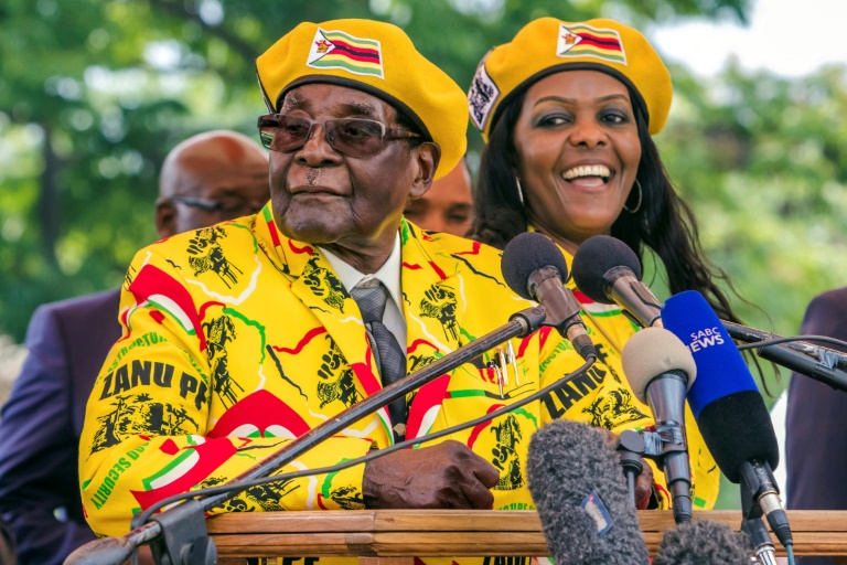 President Mugabe and his wife Grace addressed party members after the vice president, Emmerson Mnangagwa, was sacked -- a move that was followed by the military's warning on Monday | © AFP | Jekesai NJIKIZANA