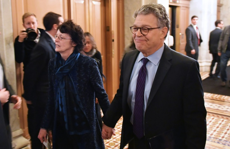 Senator Al Franken, shown with his wife Franni Bryson (L) as they arrived at the US Capitol, has said he will resign in the coming weeks, but added he was shocked at the allegations against him | © AFP | MANDEL NGAN