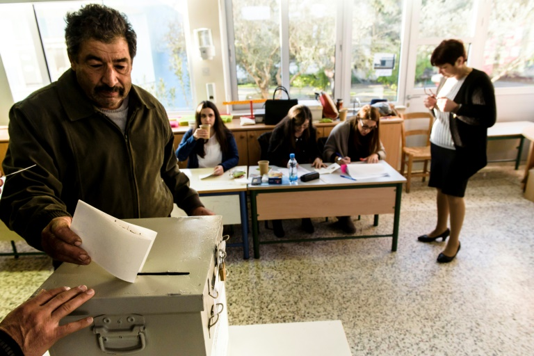 Cyprus votes for president with eyes on new peace push   AFP