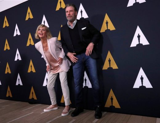 Olivia Newton-John and John Travolta boogie on red carpet at 40th