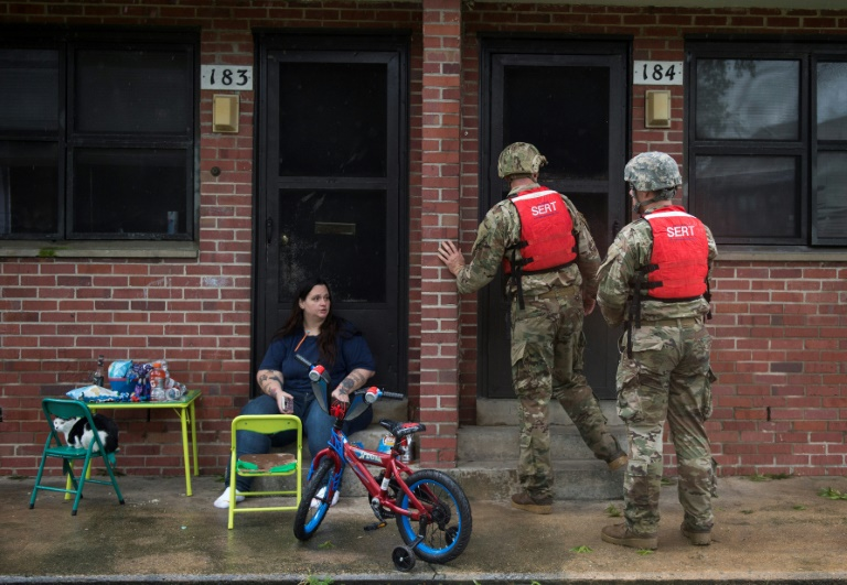 Members of the National Guard check a neighborhood in New Bern for anyone who needs help   © AFP   Andrew CABALLERO-REYNOLDS