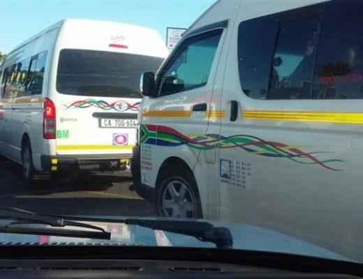 Gun-toting taxi passenger kills robber