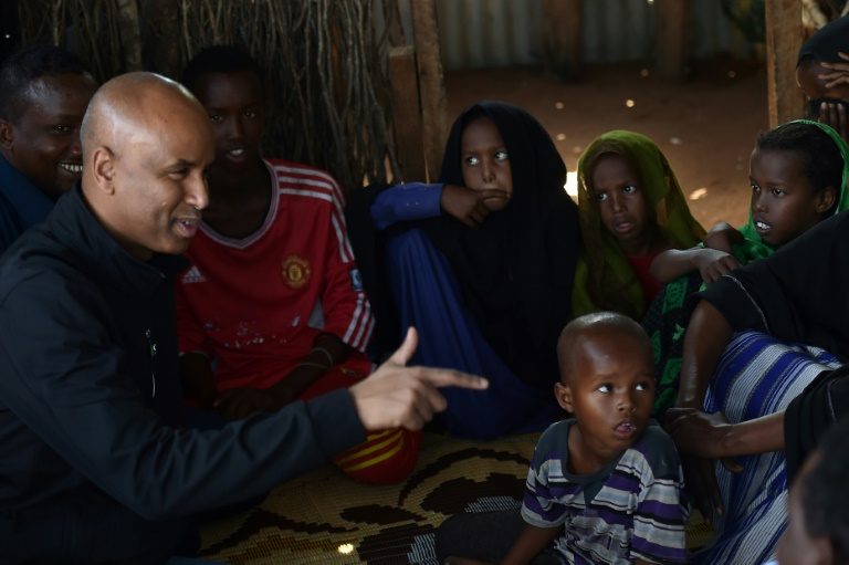 Canadian Immigration Minister Ahmed Hussen (L, pictured September 2017) said Canada is taking steps to resettle 750 ex-slaves from Libya, as well as 100 refugees from Niger | © AFP/File | TONY KARUMBA