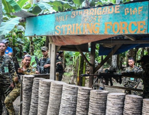 Muslim rebels hand over guns in Philippines peace deal | AFP