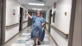 Pregnant mom in labor dances with nurses