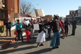 The residents who were protesting over the fact that they still did not have their allocated houses.