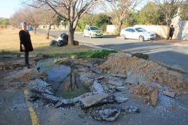 The parking area from the leakage is occurring have been dug up, but water was still leaking during the past week. Ms Anett Venter has complained about the problem for several months.