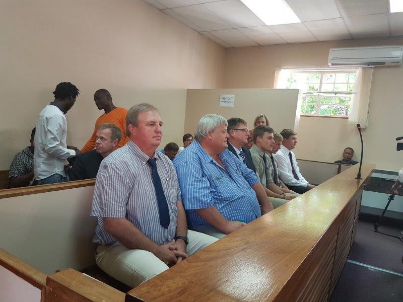 Die ses beskuldigdes wat tereg staan op twee klagte van moord na die dood van Samuel Jubeda en Simon Tjixa.