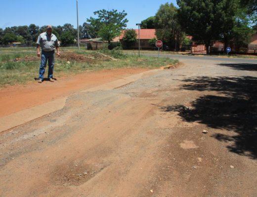 Mr Ben van den Berg at the dangerous potholes Umfolozi Street.