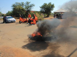 The protesters blocking the road with burning tyres last Friday