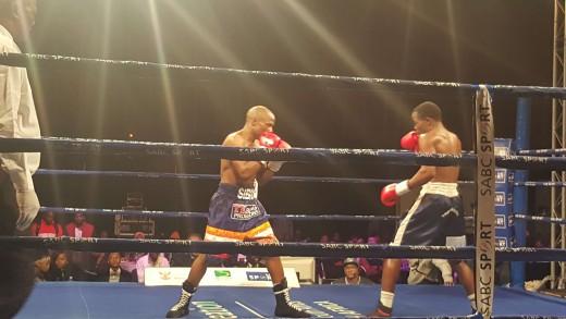 SA's Koos Sibiya battling it with Namibian boxer Samuel Kapapu.