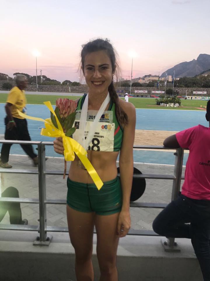Joné Kruger (NWU Pukke) is in die wolke na haar sprong van 5.92 meter in die vroue o.20 verspring tydens die ASA Jeug- en Junior Kampioenskappe waar sy goud behaal in Noordweskleure.