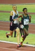 Thabang Mosiako sprints past Elroy Gelant in the men's 5000 metres event.