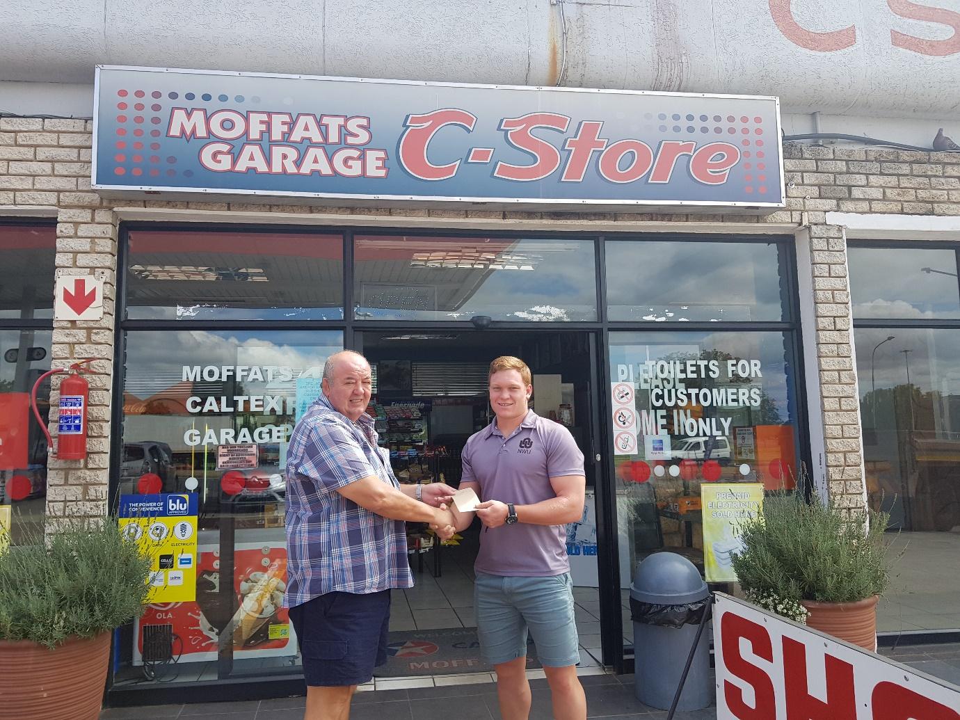 The NWU hooker, Louis van der Westhuizen receiving his petrol voucher from Caltex Moffat's owner, Tinus Potgieter.
