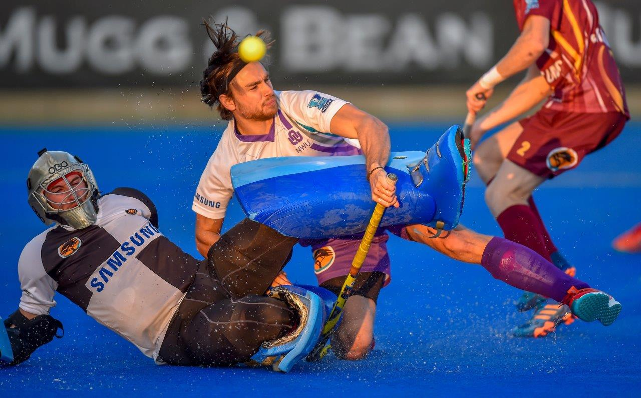 Maties' Rob McKinley and NWU's Killian Ludick collide as they tussle for possession in the Varsity Hockey semi-final at Tuks Stadium on Monday, 14 May. Maties won this match 2–0 on penalties to send NWU out of the tournament. Photo: Christiaan Kotze.SASPA