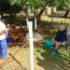 Bo: Familie, vriende en boere van die Parysomgewing kyk toe terwyl werkers die graf grawe op die familieplaas waar wyle mnr. Frans Harmse se vrou ook begrawe is. Die begrafnis vind Vrydag plaas. Hy het na 'n plaasaanval aan sy beserings gesterf. Foto: Jannie du Plessis.
