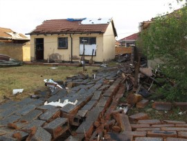 A pile of corrugated iron sheeting from a nearby church, which was swept up by the strong winds on Wednesday, November 16. The winds wrapped the corrugated sheeting into the small area at a substation.