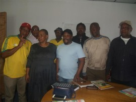 Amos Mnguni (in black cap and blue shirt), the chairperson of the Boksburg Vosloorus  Food and Beverages Association, flanked by associate members of several local liquor trading associations who will be embarking on a march in Phumula to highlight violence and domestic abuse in line with the 16 Days of Activism.