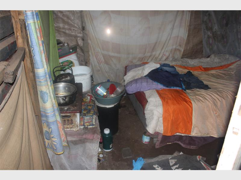 The inside of the shack where the child (three months) was locked up by her mother and was later found dead.