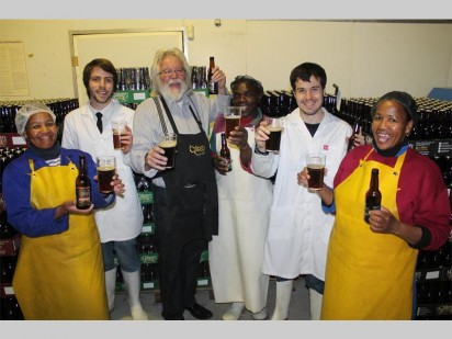 Staff members at the Gilroy's Brewery in Muldersdrift celebrating the news that James Bond author Jeffery Deaver confirmed the Gilroy's dark ale mentioned in his book is brewed by them. From the left are Elizabeth Simongo, Michael Biljon (brewery manager), Steve Gilroy, Lawrence Sigama, Kyle Cloete and Margaret Ndhlebe.
