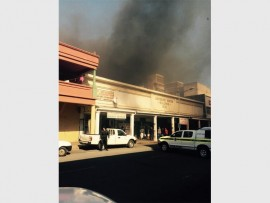 Black smoke creep over businesses as rubbish caught fire.