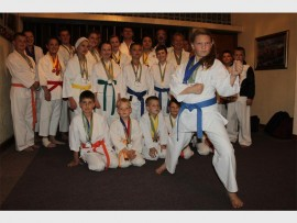Danike de Beer in a stance with the other 53 karatekas who were selected to represent South Africa at the JSKA national team.