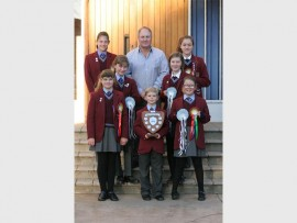 The Monument Primary School Equestrian Team consists of (back row) Alara Eich, Mark Moore and  Alexandra Swart. Middle row: Kathleen Rose Caroto and Jorden Kelly Smith. Front row: Taryn and Calan Campbell and Chadé Smith.