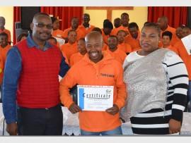 "Joseph ""Duku Duku"" Makhanya (centre) receiving his certificate from Lerato Mbonyane and Oupa Mosikari (left). Photo: Sipho None."