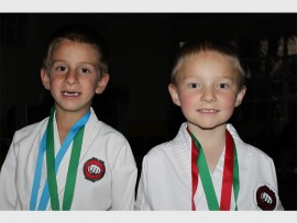 On the left is Christiaan Lambrecht (6), who won a gold medal for his kata and Nathan van den Berg won a silver medal for kumite.
