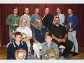 Caxton Khosa Cricket's club members with the various trophies they have won.